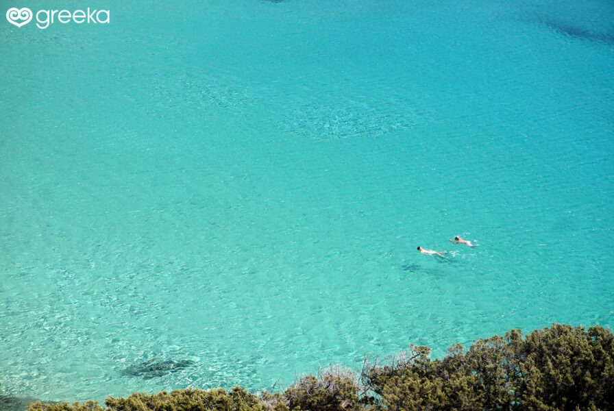 Swimming in the crystal clear waters of Kedros beach, Donoussa