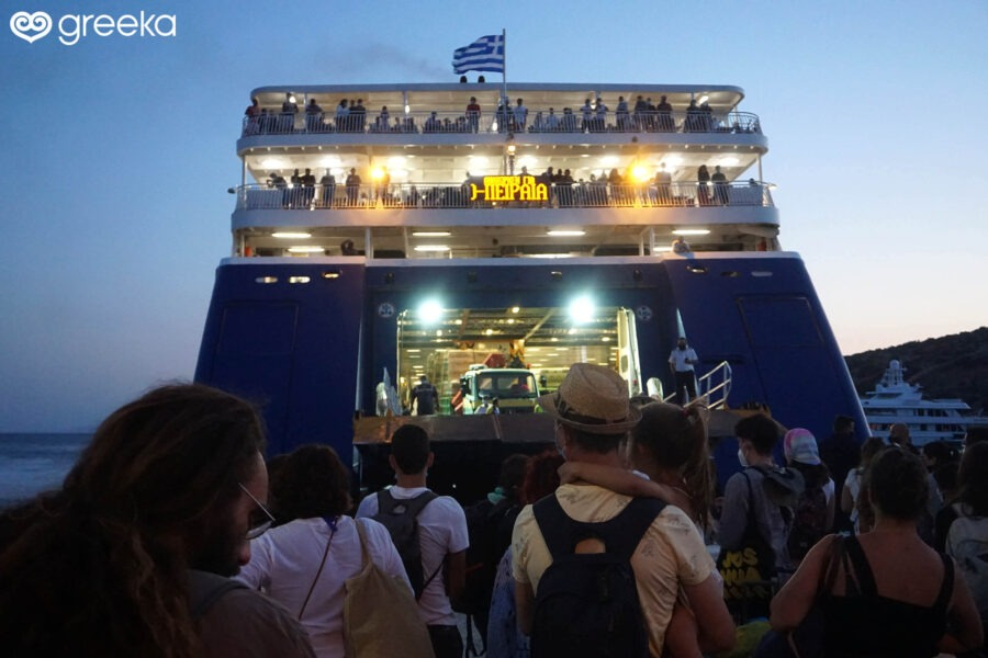 Boarding a ferry from an island to Piraeus