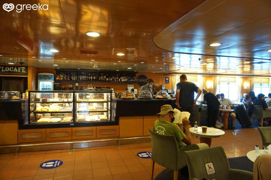 An indoor self-service cafeteria for a coffee and a snack.